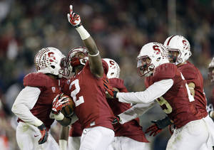 Photo - Stanford cornerback Wayne Lyons (2) celebrates after intercepting a pass against Notre Dame during the second half of an NCAA college football game on Saturday, Nov. 30, 2013, in Stanford, Calif. Stanford won 27-20. (AP Photo/Marcio Jose Sanchez)