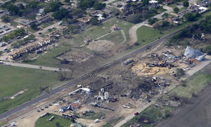 Photo - This April 18, 2013 file photo shows an aerial view of the remains of a fertilizer plant and an apartment complex to the left, destroyed by an explosion in West, Texas.  The government has failed to inspect virtually all of the chemical facilities that it considers to be at high risk for a terror attack, numbering in the thousands, and has underestimated the threat to densely populated cities, congressional investigators say.  (AP Photo/Tony Gutierrez, File)
