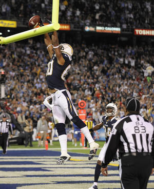 Photo -   San Diego Chargers wide receiver Malcom Floyd celebrates his touchdown reception against the Kansas City Chiefs, tipping the ball over the crossbar during the second half of an NFL football game Thursday, Nov. 1, 2012, in San Diego. (AP Photo/Denis Poroy)