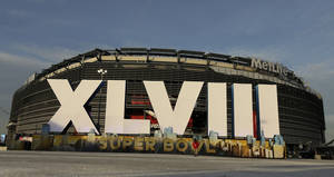 Photo - A sign for NFL football's Super Bowl XLVIII stands in front of MetLife Stadium Sat. Feb. 1, 2014, in East Ruthoford, N.J. The stadium will be the site of Sunday's championship game between the Denver Broncos and the Seattle Seahawks. (AP Photo/Charlie Riedel)