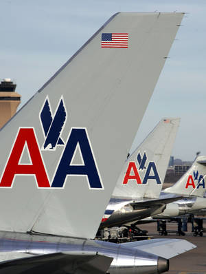 Photo - American Airlines aircraft are shown parked at a terminal at DFW International Airport in Grapevine, Texas. AP Photo