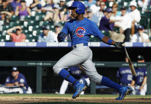 Photo - FILE - In this July 21, 2013, file photo, Chicago Cubs' Alfonso Soriano grounds out to drive in a run against the Colorado Rockies in the ninth inning of a baseball game in Denver. The New York Yankees have acquired Soriano in a trade with the Cubs on Friday, July 26, 2013, returning the seven-time All-Star to the team where he began his career. The Cubs received minor league right-hander Corey Black and cash from New York. (AP Photo/David Zalubowski, File)