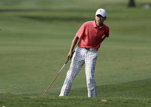 Photo - Amateur Guan Tianlang, 14, of China looks down the fairway before hitting on his approach to the 15th green during the first round of the Byron Nelson Championship golf tournament, Thursday, May 16, 2013, in Irving, Texas. (AP Photo/Tony Gutierrez)
