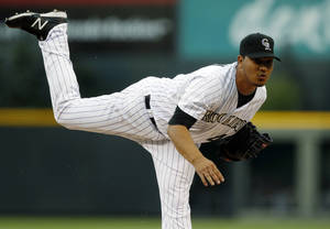 Photo -   Colorado Rockies starting pitcher Jhoulys Chacin throws to San Diego Padres batter Everth Cabrera in the first inning of a baseball game in Denver on Saturday, Sept. 1, 2012. (AP Photo/David Zalubowski)