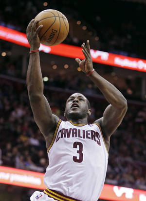 Photo - Cleveland Cavaliers' Dion Waiters goes up for a shot against the Detroit Pistons in the fourth quarter of an NBA basketball game Wednesday, April 9, 2014, in Cleveland. Waiters led the Cavaliers with 22 points in their 122-100 win. (AP Photo/Mark Duncan)