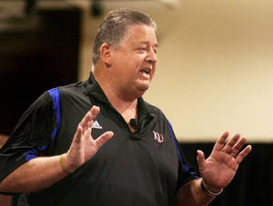 photo - New Kansas football coach Charlie Weis has learned a few lessons since his days at Notre Dame. AP photo