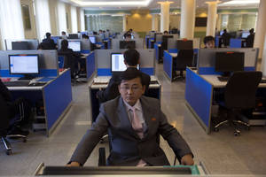 Photo - FILE - In this Jan. 8, 2013 file photo, a North Korean student works at a computer terminal inside a computer lab at Kim Il Sung University in Pyongyang, North Korea, during a tour by Executive Chairman of Google, Eric Schmidt. North Korea is literally off the charts regarding Internet freedoms. There essentially aren't any. But the country is increasingly online. Though it deliberately and meticulously keeps its people isolated and in the dark about the outside world, it knows it must enter the information age to survive in the global economy. (AP Photo/David Guttenfelder, File)