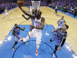 Photo - Oklahoma City Thunder forward Kevin Durant (35) shoots in front of Memphis Grizzlies guard Mike Conley (11), guard Tony Allen (9) and forward Mike Miller (13) in the second quarter of Game 7 of an opening-round NBA basketball playoff series in Oklahoma City, Saturday, May 3, 2014. (AP Photo/Sue Ogrocki)