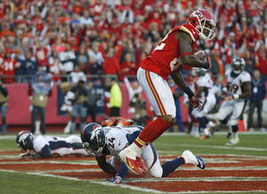 Photo - Kansas City Chiefs wide receiver Dwayne Bowe (82) makes a touchdown reception against Denver Broncos cornerback Champ Bailey (24) during the first half of an NFL football game, Sunday, Dec. 1, 2013, in Kansas City, Mo. (AP Photo/Orlin Wagner)