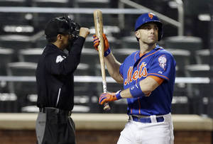 Photo - New York Mets' David Wright reacts after striking out during the eleventh inning of a baseball game against the Philadelphia Phillies, Friday, May 9, 2014, in New York. The Phillies game 3-2. (AP Photo/Frank Franklin II)