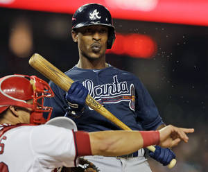 Photo - FILE - In this Aug. 6, 2013 file photo, Atlanta Braves' B.J. Upton reacts after a called third strike during the ninth inning of a baseball game against the Washington Nationals at Nationals Park in Washington. Spring training is Upton's chance for a fresh start after hitting .184 and losing his starting job in his Atlanta debut. (AP Photo/Alex Brandon, File)