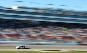 Photo - Brad Keselowski drives during qualifying for Sunday's NASCAR Sprint Cup Series auto race on Friday, March 7, 2014, in Las Vegas. (AP Photo/Isaac Brekken)