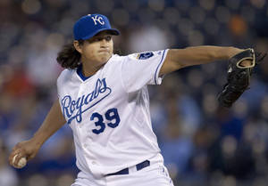 Photo -   Kansas City Royals starting pitcher Luis Mendoza works against a Cleveland Indians batter during the first inning of a baseball game at Kauffman Stadium in Kansas City, Mo., Friday, Sept. 21, 2012. (AP Photo/Orlin Wagner)