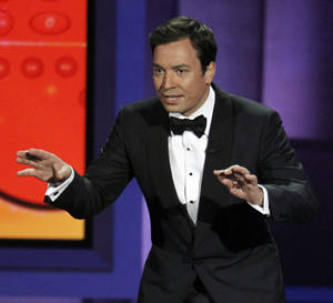 "Photo -   FILE - In this Aug. 29, 2010 file photo, host Jimmy Fallon presents during the 62nd Primetime Emmy Awards in Los Angeles. Fallon told Matt Lauer on Wed., Aug. 8, 2012 during a ""Today"" show broadcast, that he was asked to host next year's 85th Academy Awards but declined the gig. (AP Photo/Chris Carlson, File)"