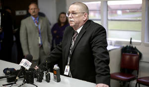 Photo -                    Robert Patton, director of the Department Corrections, talks with members of the media after the attempted execution of Clayton Lockett.                                        PHOTO BY JOHN CLANTON, THE OKLAHOMAN