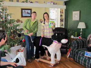 Photo - This 2010 photo released by Katie Jackson shows, Margaret Smith, left, and her niece Katie Jackson with a stuffed dog Jackson received for Christmas in Lewistown, Mont. For the past three years, Jackson has asked for a Leonberger, one of those gentle giant breeds that can cost up to $1,500 and would occupy a good chunk of her Long Island City apartment.  While her parents have good reasons for not granting her wish, including cost and size, other people aren't so sure why their numerous gift hints year after year yield a big fat nothing, even when their sought-after treasures aren't out-of-this-world expensive. (AP Photo/Becky Jackson)
