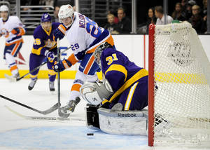 Photo - New York Islanders center Brock Nelson (29) takes a shot on Los Angeles Kings goalie Martin Jones (31) during the first period of an NHL hockey game on Saturday, Dec. 7, 2013, in Los Angeles.(AP Photo/Gus Ruelas)
