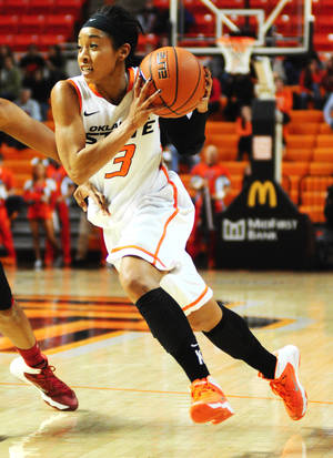 Photo - Oklahoma State guard Tiffany Bias drives to the basket during the Oklahoma State womens' basketball game versus Southern California on Nov. 22, 2013 at Gallagher Iba Arena in Stillwater, Okla. Photo by KT King/For the Oklahoman