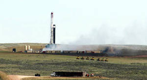 Photo -   This image provided by the Glenrock Bird shows an out-of-control oil well spewing natural gas a few miles northeast of Douglas in east-central Wyoming on Wednesday April 25, 2012. A blowout occurred at the well Tuesday afternoon. More than 60 people living nearby evacuated from their homes while crews began work to plug the well with drilling mud and avoid an explosion. Nobody was hurt.(AP Photo/Glenrock Bird)