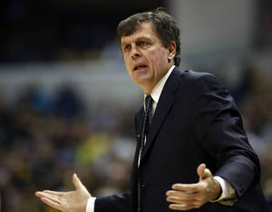 Photo - Houston Rockets head coach Kevin McHale questions an official's call in the first half of an NBA basketball game against the Indiana Pacers in Indianapolis, Friday, Dec. 20, 2013. (AP Photo/R Brent Smith)