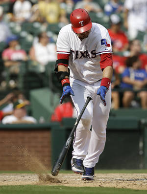 Photo - Texas Rangers' A.J. Pierzynski slams his bat to the ground after flying out to left off a pitch from Pittsburgh Pirates relief pitcher Bryan Morris in the eighth inning of a baseball game, Wednesday, Sept. 11, 2013, in Arlington, Texas. The Pirates won 7-5.  (AP Photo/Tony Gutierrez)