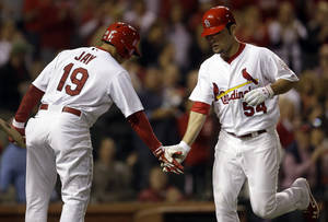 Photo -   St. Louis Cardinals' Jaime Garcia, right, is congratulated by teammate Jon Jay after hitting a solo home run during the third inning of a baseball game against the Cincinnati Reds, Monday, Oct. 1, 2012, in St. Louis. (AP Photo/Jeff Roberson)