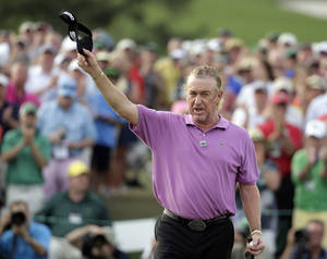 Photo - Miguel Angel Jimenez, of Spain, holds up his visor on the 18th hole following his fourth round of the Masters golf tournament Sunday, April 13, 2014, in Augusta, Ga. (AP Photo/Chris Carlson)