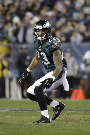 Photo - FILE - In this Dec. 22, 2013, file photo, Philadelphia Eagles' Patrick Chung follows the action during the second half of an NFL football game against the Chicago Bears in Philadelphia. Patriots have signed Chung on Thursday, April 3, 0214, after spending last season with the Eagles. He had played his previous four seasons with New England after being drafted in the second round in 2009. (AP Photo/Matt Rourke, File)
