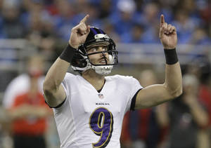 Photo - Baltimore Ravens kicker Justin Tucker (9) reacts after one of his six field goals during an NFL football game against the Detroit Lions in Detroit, Monday, Dec. 16, 2013. (AP Photo/Duane Burleson)