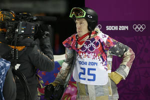Photo - Shaun White, of the United States, looks at the scoreboard after competing in the men's snowboard halfpipe final at the Rosa Khutor Extreme Park, at the 2014 Winter Olympics, Tuesday, Feb. 11, 2014, in Krasnaya Polyana, Russia. White placed fourth. (AP Photo/Jae C. Hong)