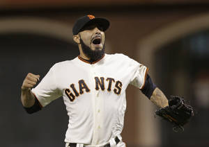 Photo -   San Francisco Giants' Sergio Romo reacts after the Giants defeated the Detroit Tigers, 2-0, in Game 2 of baseball's World Series Thursday, Oct. 25, 2012, in San Francisco. (AP Photo/Marcio Jose Sanchez)