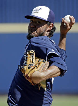 Photo - Milwaukee Brewers' Yovani Gallardo throws before the first inning of an exhibition spring training baseball game against the Chicago White Sox Monday, March 10, 2014, in Phoenix. (AP Photo/Morry Gash)