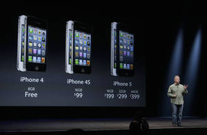 Photo -   Phil Schiller, Apple's senior vice president of worldwide marketing, gives prices of the iPhone 5 during an Apple event in San Francisco, Wednesday, Sept. 12, 2012. (AP Photo/Jeff Chiu)