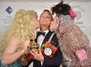 Photo - Actor Kiefer Sutherland reacts as he is honored as the Hasty Pudding Man of the Year at Harvard University in Cambridge, Mass., Friday, Feb. 8, 2013. Sutherland was roasted and received the pudding pot from the nation's oldest undergraduate drama troupe. (AP Photo/Josh Reynolds)
