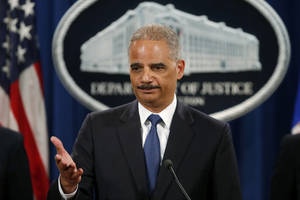 "Photo - FILE - This May 19, 2014 file photo shows Attorney General Eric Holder taking questions during a news conference at the Justice Department in Washington where he announced that a U.S. grand jury has charged five Chinese hackers with economic espionage and trade secret theft. In a 31-count indictment, the Justice Department said five Chinese military officials operating under hacker aliases such as ""Ugly Gorilla,"" ""KandyGoo"" and ""Jack Sun"" stole confidential business information, sensitive trade secrets and internal communications for competitive advantage. The U.S. identified the alleged victims as Alcoa World Alumina, Westinghouse, Allegheny Technologies, U.S. Steel, United Steelworkers Union and SolarWorld. China denied it all.  (AP Photo/Charles Dharapak, File)"