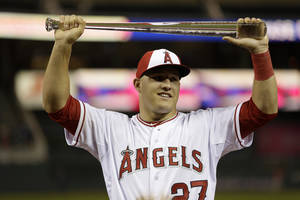Photo - American League outfielder Mike Trout, of the Los Angeles Angels, holds the MVP trophy after his team's 5-3 victory over the National League in the MLB All-Star baseball game, Tuesday, July 15, 2014, in Minneapolis. (AP Photo/Jeff Roberson)