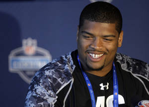 Photo - Oklahoma's Trent Williams answers a question during a press conference at the NFL Scouting Combine in Indianapolis on Thursday. The event allows teams to evaluate the nation's top college football players eligible for the upcoming NFL Draft. AP Photo