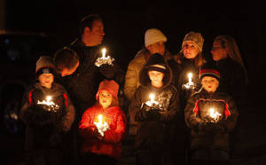 photo - Mourners gather for a candlelight vigil at Ram's Pasture to remember shooting victims, Saturday, Dec. 15, 2012 in Newtown, Conn.  A gunman walked into Sandy Hook Elementary School in Newtown Friday and opened fire, killing 26 people, including 20 children. (AP Photo/Jason DeCrow) ORG XMIT: CTJD124