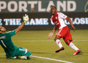 Photo - Timbers forward (6) Darlington Nagbe curls a shot around FC Dallas keeper (1) Raul Fernandez to score the Timbers' second goal in the first half.  The Portland Timbers led FC Dallas 2-1 at half in Portland.   (AP Photo/The Oregonian, Doug Beghtel)