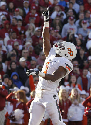 photo -   Oklahoma State running back Joseph Randle celebrates a touchdown against Oklahoma in the second quarter of an NCAA college football game in Norman, Okla., Saturday, Nov. 24, 2012. (AP Photo/Sue Ogrocki)