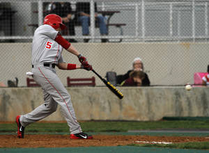 Photo - HIGH SCHOOL BASEBALL: Yukon's Landon Eason (5) during a game between Yukon and Edmond Memorial in Edmond, Friday, March 16, 2012.  Photo by Garett Fisbeck, For The Oklahoman