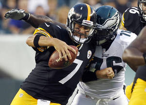 Photo -   FILE - In this Aug. 9, 2012, file phot, Pittsburgh Steelers quaterback Ben Roethlisberger (7) is sacked by Philadelphia Eagles tackle Thomas Welch (76) during the first half of an NFL preseason football game in Philadelphia. Roethlisberger recalls getting knocked around pretty hard and not finishing the game the last time he faced the Eagles, who haven't hit quarterbacks quite as often as they're used to so far this season. (AP Photo/Mel Evans, File)