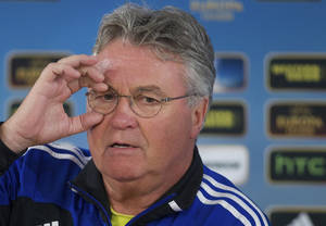 Photo - FILE - In this Wednesday March 6, 2013 file photo, Anzhi's head coach Guus Hiddink speaks during a news conference, at Luzhniki stadium in Moscow, Russia. Guus Hiddink will take over as Netherlands coach after the World Cup, when Louis van Gaal is stepping down, the country's football association announced on Friday March 28, 2014. (AP Photo/Ivan Sekretarev, File)