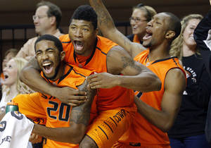 photo - OSU / CELEBRATION: Oklahoma State&#039;s Michael Cobbins (20),  Marcus Smart (33) and Kamari Murphy (21) celebrate a three-pointer from Alex Budke (23) during the men&#039;s college basketball game between Oklahoma State University and Central Arkansas at Gallagher-Iba Arena in Stillwater, Okla., Sunday,Dec. 16, 2012. Photo by Sarah Phipps, The Oklahoman