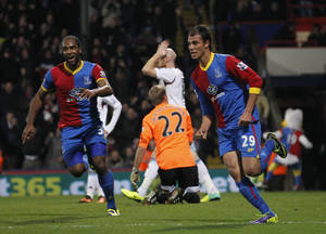 Photo - Crystal Palace's Marouane Chamakh, right, celebrates his goal against West Ham United with teammate Cameron Jerome, left, during their English Premier League soccer match at Selhurst Park, London, Tuesday, Dec. 3, 2013. (AP Photo/Sang Tan)