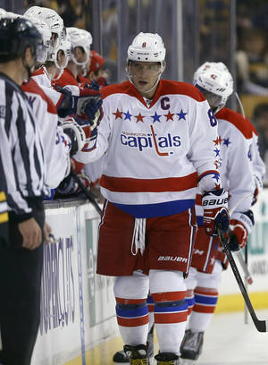 Photo - Washington Capitals' Alex Ovechkin (8) celebrates his goal in the second period of an NHL hockey game against the Boston Bruins in Boston, Saturday, March 1, 2014. (AP Photo/Michael Dwyer)