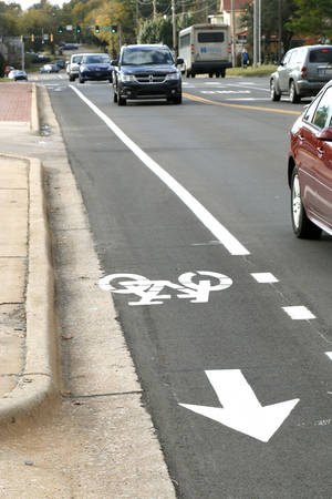 Photo -  Automobiles drive past the city of Edmond's first bike lane along University Boulevard. PHOTO BY PAUL HELLSTERN, THE OKLAHOMAN  <strong>PAUL HELLSTERN -   </strong>