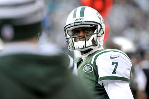 Photo - New York Jets quarterback Geno Smith looks on after being pulled  during the second half of an NFL football game against the Miami Dolphins, Sunday, Dec. 1, 2013, in East Rutherford, N.J. (AP Photo/Bill Kostroun)