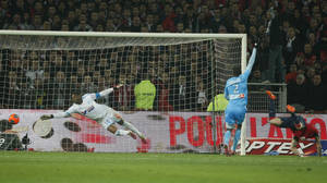 Photo - Lille's Nolan Roux, right, scores against Marseille during his French League one soccer match at the Lille Metropole stadium, in Villeneuve d'Ascq, northern France, Tuesday, Dec. 3, 2013. (AP Photo/Michel Spingler)