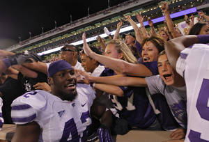 Photo - CELEBRATION: Kansas State's Meshak Williams (42) celebrates the 24-19 win over Oklahoma with the Wildcat fans during the college football game between the University of Oklahoma Sooners (OU) and the Kansas State University Wildcats (KSU) at the Gaylord Family-Oklahoma Memorial Stadium on Saturday, Sept. 22, 2012, in Norman, Okla. Photo by Chris Landsberger, The Oklahoman